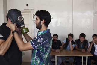 Mohammad Zayed Teaches Local Citizens To Use Gas Masks AFP Getty Images Jim